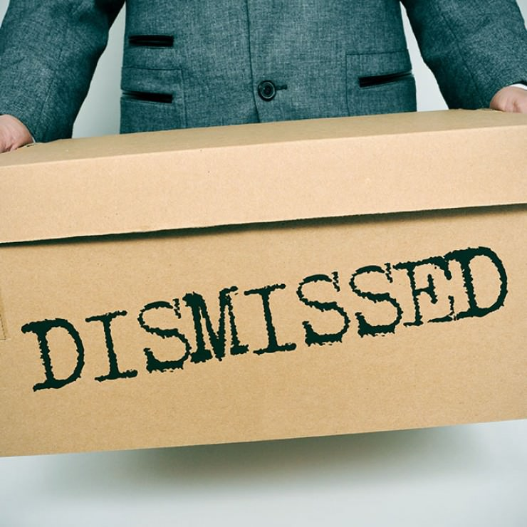 man-holding-box-saying-DISMISSED.jpg